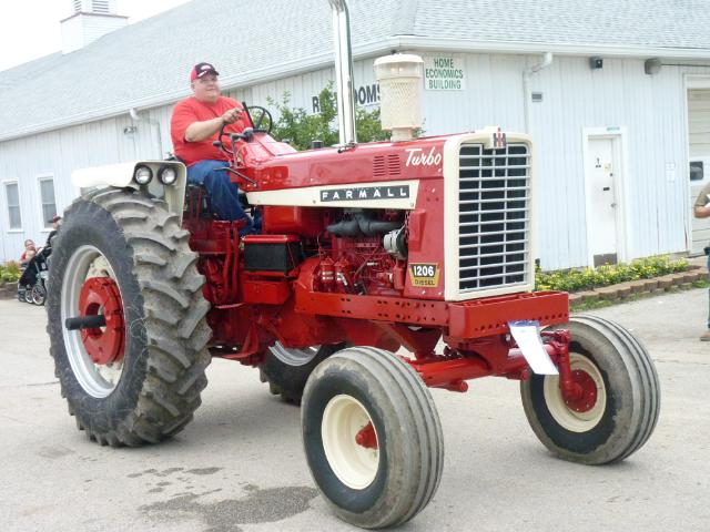 Farmall 1206 Diesel Tractor in Antique Tractor Parade at the fair