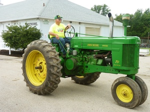 Vintage John Deere Tractor in Antique Tractor Parade at County Fair